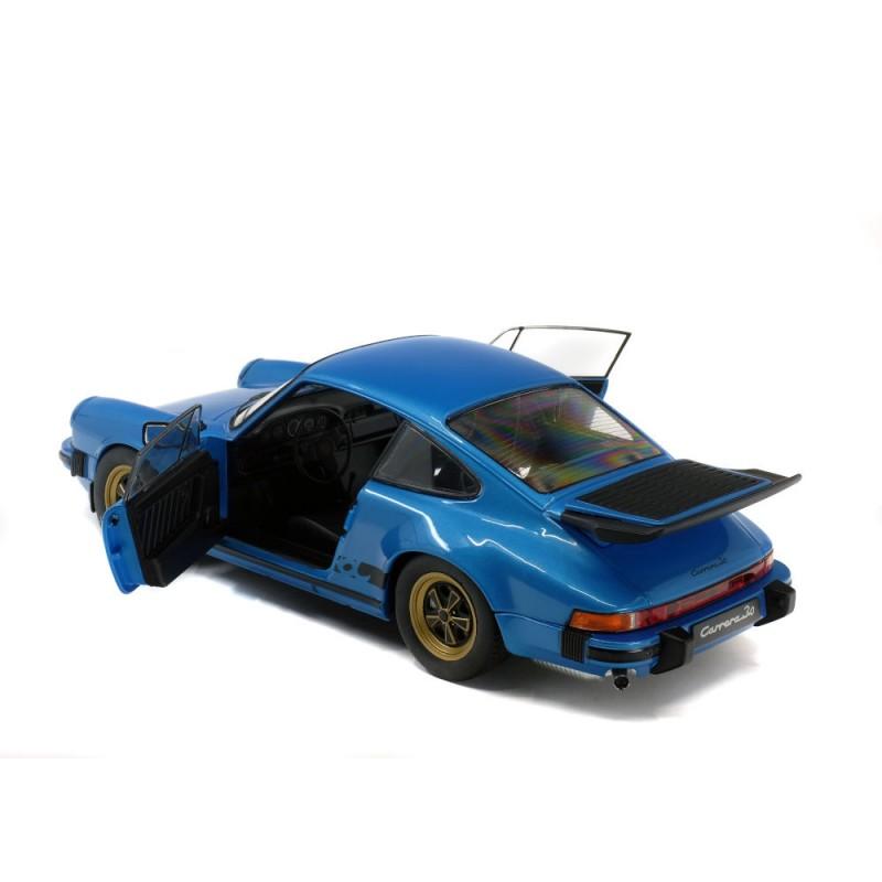 Macheta auto Porsche 911 Carrera 3,0 Coupe albastru 1984, 1:18 Solido